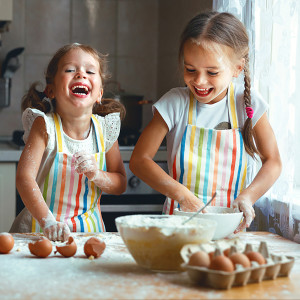 happy sisters children girls bake cookies, knead dough, play with flour and laugh in the kitchen ; Shutterstock ID 709088398; Job (TFH, TOH, RD, BNB, CWM, CM): TOH Julia Child